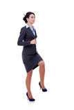 Mujer de negocios que camina en el paso de progresión imaginario Fotos de archivo
