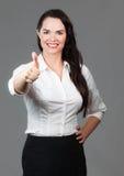 Mujer de negocios que da los pulgares para arriba Foto de archivo libre de regalías