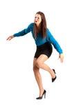 Mujer de negocios que dispara o que cae en tacones altos foto de archivo libre de regalías
