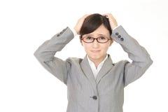 Mujer de negocios que es confusa Fotografía de archivo