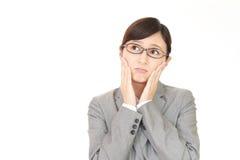 Mujer de negocios que es confusa Imagen de archivo libre de regalías