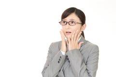 Mujer de negocios que es confusa Imágenes de archivo libres de regalías