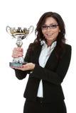 Mujer de negocios que gana un trofeo Imagen de archivo libre de regalías