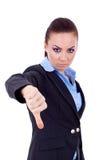 Mujer de negocios que gesticula los pulgares abajo Fotografía de archivo libre de regalías