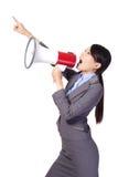 Mujer de negocios que grita con un megáfono Fotos de archivo