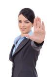 Mujer de negocios que hace la muestra de la parada Imagen de archivo