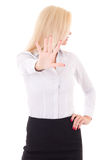 Mujer de negocios que hace la muestra de la parada aislada en el fondo blanco Imagen de archivo