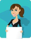 Mujer de negocios que lleva a cabo a la tarjeta en blanco Foto de archivo libre de regalías