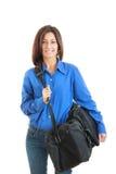 Mujer de negocios que lleva el bolso grande del viaje Foto de archivo libre de regalías