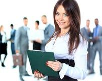 Mujer de negocios que lleva a su equipo encima Imágenes de archivo libres de regalías