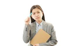 Mujer de negocios que parece difícil. Imagen de archivo