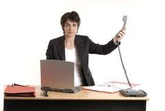 Mujer de negocios que pasa el teléfono Fotos de archivo libres de regalías