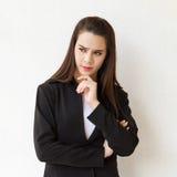 Mujer de negocios que piensa con la tensión Fotos de archivo
