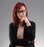 Mujer de negocios que piensa en algo Imagen de archivo