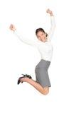 Mujer de negocios que salta en éxito Fotografía de archivo libre de regalías
