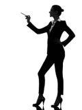 Mujer de negocios que señala mostrando la silueta Imágenes de archivo libres de regalías