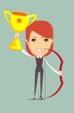Mujer de negocios que soporta el trofeo y el arco que ganan Fotos de archivo