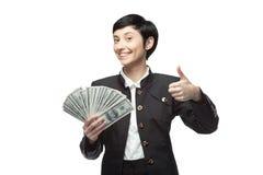 Mujer de negocios que sostiene el dinero Fotos de archivo libres de regalías