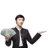 Mujer de negocios que sostiene el dinero Fotos de archivo