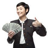 Mujer de negocios que sostiene el dinero Imágenes de archivo libres de regalías