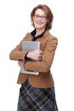 Mujer de negocios que sostiene la computadora portátil Imagen de archivo libre de regalías