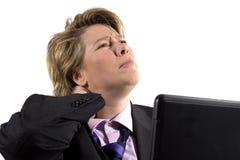 Mujer de negocios que tiene apuro del cuello Imagenes de archivo