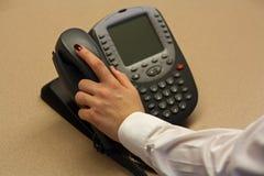 Mujer de negocios que toma el teléfono Foto de archivo libre de regalías