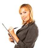 Mujer de negocios que toma notas Foto de archivo