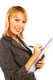 Mujer de negocios que toma notas Fotos de archivo libres de regalías