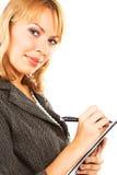 Mujer de negocios que toma notas Foto de archivo libre de regalías
