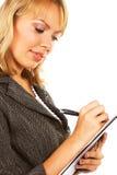 Mujer de negocios que toma notas Imagen de archivo libre de regalías
