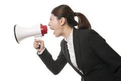 Mujer de negocios que usa un megáfono Foto de archivo libre de regalías