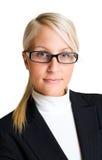 Mujer de negocios rubia confidente. Foto de archivo libre de regalías