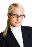 Mujer de negocios rubia confidente. Fotografía de archivo