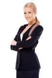 Mujer de negocios rubia linda en blanco Imagen de archivo