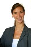 Mujer de negocios sonriente atractiva imagen de archivo