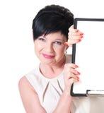 Mujer de negocios sonriente con el espacio en blanco Foto de archivo libre de regalías