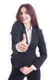 Mujer de negocios sonriente feliz que muestra como gesto Fotografía de archivo libre de regalías