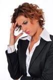 Mujer de negocios tensionada con un dolor de cabeza Imágenes de archivo libres de regalías