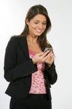 Mujer de negocios y un teléfono Imagen de archivo libre de regalías