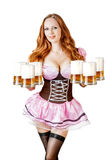 Mujer de Oktoberfest que sostiene seis tazas de cerveza Fotos de archivo libres de regalías