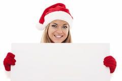Mujer de Papá Noel con el tablero en blanco Fotos de archivo libres de regalías