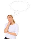 Mujer de pensamiento con la burbuja en blanco del pensamiento Foto de archivo libre de regalías
