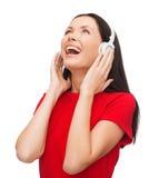 Mujer de risa con los auriculares Fotografía de archivo