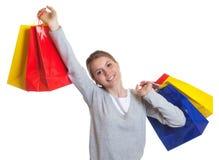 Mujer de risa con 5 panieres coloridos Imágenes de archivo libres de regalías