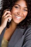 Mujer de risa del teléfono fotografía de archivo