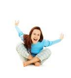 Mujer de risa en pijamas azules Imagen de archivo libre de regalías