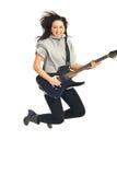 Mujer de salto del guitarrista Foto de archivo libre de regalías