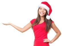 Mujer de Santa que muestra el producto Imágenes de archivo libres de regalías