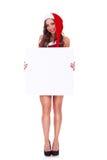 Mujer de Santa que presenta a una tarjeta en blanco Fotografía de archivo libre de regalías